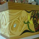 "Wolf Hummingbird Chest  Size: 6 1/2"" x 9"" x 6""   Hand carved and painted  steam bent yellow cedar  Design meaning: Represents intelligence, leadership, loyalty and family values. Agility, Love, Beauty and healing"