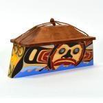 "Sun Moon Canoe Box  Size:8 1/2"" x 16 1/2"" x 7""  Carved and painted steam bent yellow cedar with red cedar top   Design meaning: Provides the earth with healing energy and life. Protector. Guardian"